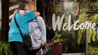 Families are reunited as travellers arrive on the first flight from Sydney, in Wellington.