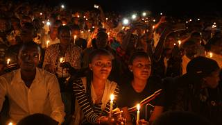 In this Sunday, April 7, 2019 file photo, people attend a candlelit vigil during a memorial service marking 25 years since the genocide, in Kigali, Rwanda.