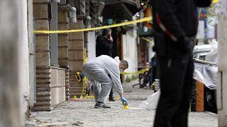 A policeman investigates the area outside Dine Hoxha mosque in Tirana.