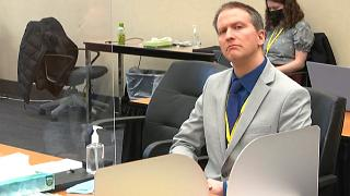 Former Minneapolis police Officer Derek Chauvin listens as his defense attorney Eric Nelson gives closing arguments. April 19, 2021