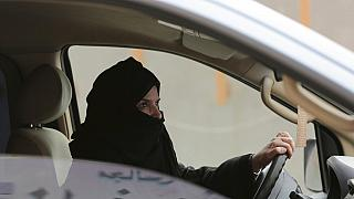 FILE - In this March 29, 2014 file photo, Aziza al-Yousef drives a car on a highway during a women's rights campaign in Riyadh, Saudi Arabia.