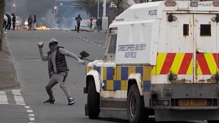 Youth attacking police vehicle