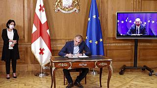 The deal aims to end a months-long political crisi since October's parliamentary elections.