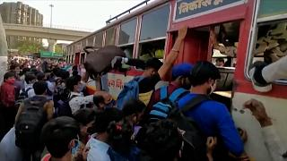 Workers trying to get in buses