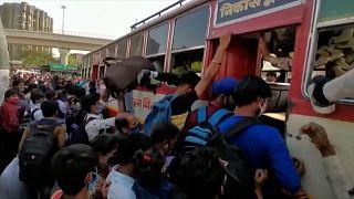 Workers flee New Delhi as week-long lockdown is announced