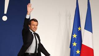 Then-presidential candidate Emmanuel Macron waves to the crowd during a campaign rally in Chatellerault, central France, Friday, April 28, 2017.