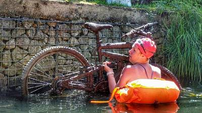 Lifting a bike out of the water