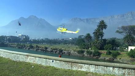 Crews work to extinguish wildfire on Table Mountain