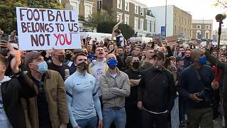 Chelsea fans gathering outside Stamford Bridge to protest against the proposed European Super League