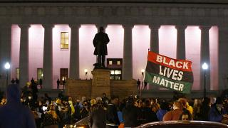 A crowd gathers in front of the Ohio Statehouse during a protestTuesday, April 20, 2021, in Columbus, Ohio. Police shot and killed a teenage girl.