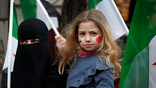 A child stands during a rally in Istanbul on Thursday, February 22, 2018, against attacks on the suburb of eastern Ghouta in Syria's capital Damascus.