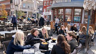 People enjoy outdoor service in Roskilde, Denmark.