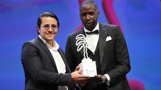 صورة من الارشيف - الممثل الفرنسي إبراهيم بوهليل (إلى اليسار)- الحفل الختامي للدورة الثالثة لمهرجان كان الدولي 2020