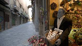 Via San Gregorio Armeno, famous for its statuettes, is empty, in downtown Naples, southern Italy, Wednesday, March 11, 2020.