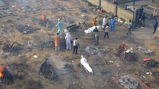 Grounds have been turned into mass cremation sites as as India's COVID death toll skyrockets