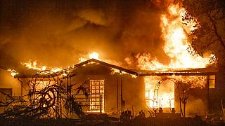 Sept. 27, 2020, a house burns at the Zogg Fire near Ono, Calif. California
