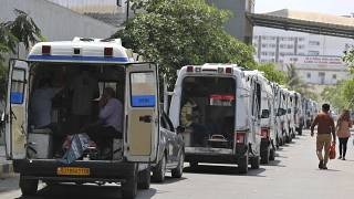 Ambulances carrying COVID-19 patients line up waiting for their turn to be attended at a dedicated COVID-19 government hospital in Ahmedabad, India