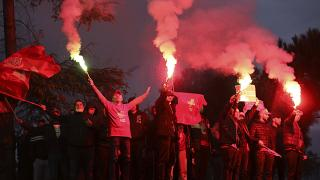 Supporters of the Socialist Movement for Integration (LSI) hold flares during a rally of their party in Tirana, Albania, Thursday, April 22, 2021.