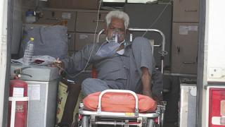 A COVID-19 patient waits inside an ambulance to be attended to and admitted into a dedicated COVID-19 government hospital in Ahmedabad, India.