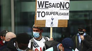 Tottenham fans stage a protest against the Board over the planned creation of a European Super League, outside the Tottenham Hotspur Stadium, Wednesday April 21, 2021.