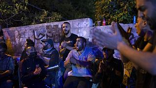 Palestinians singing during a protest in east Jerusalem on Friday