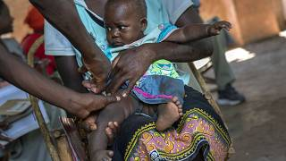 In this Dec. 11, 2019 file photo, a baby from the Malawi village of Tomali is injected with the world's first vaccine against malaria in a pilot programme.