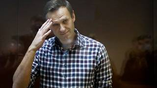 Russian opposition leader Alexei Navalny stands in a cage in the Babuskinsky District Court in Moscow, Russia, Feb. 20, 2021.