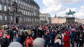 People attend a demonstration against the tightening of Denmark's migration policy in Copenhagen on Wednesday