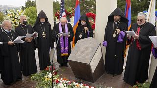 Religious leaders sing at a ceremony at the Montebello Armenian Genocide Monument in Montebello, Calif., Saturday, April 24, 2