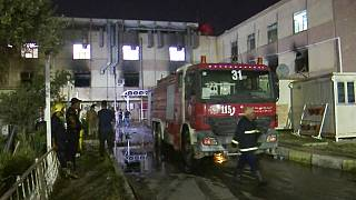 First responders work the scene of a hospital fire in Baghdad on Saturday, April 24, 2021