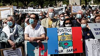 "A woman holds a placard reading ""Justice for Sarah"" as people gather to ask justice for late Sarah Halimi on Trocadero plaza in Paris on April 25, 2021"
