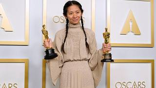 """Chloe Zhao, winner of the awards for best picture and director for """"Nomadland,"""" poses in the press room at the Oscars on April 25, 2021, in Los Angeles."""