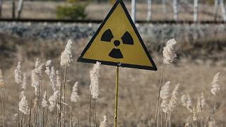 A radiation sign outside the deserted town of Pripyat, some 3 kilometers (1.86 miles) from the Chernobyl nuclear power plant in Ukraine, Tuesday, Feb. 4, 2020
