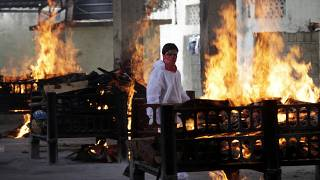 Flames rise from cremation pyres of victims of a fire that broke out in Vijay Vallabh COVID-19 hospital, at Virar, near Mumbai, India, Friday, April 23, 2021.