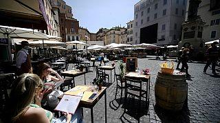 People take a lunch in a restaurant in Campo dei Fiori square in downtown Rome