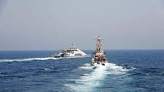 (April 2) Iranian vessel cuts across a US Navy ship as political tension in the Gulf increases