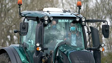 William and Kate drive tractor during farm visit