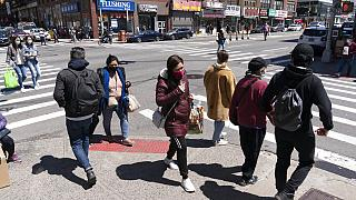 People walk on the street, Monday, April 26, 2021 in New York