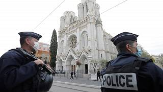 police officers stand guard near Notre Dame church in Nice, southern France on October 29, 2020.