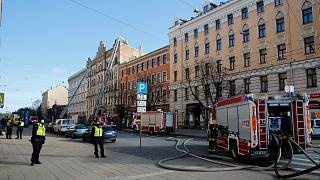 The Latvian State Fire and Rescue Service works at the site of a fire, in Riga, Latvia, Wednesday, April 28, 2021.