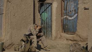 A U.S. Marine from 3rd Battalion, 6th Marine Regiment sits alone after a patrol