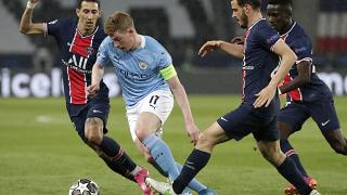 PSG's Alessandro Florenzi, 2nd right, and PSG's Angel Di Maria, left, challenge Manchester City's Kevin De Bruyne