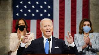 Vice President Kamala Harris, and House Speaker Nancy Pelosi of Calif., stand and applaud as President Joe Biden addresses a joint session of Congress. April 28, 2021.