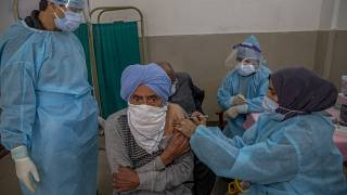 A man receives the COVISHIELD vaccine for COVID-19 at a primary health center in Srinagar, Indian controlled Kashmir, Wednesday, April 28, 2021.