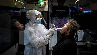 A person is tested inside a mobile coronavirus testing facility, in Ishoej, Denmark.