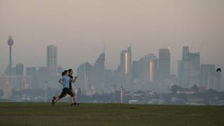 People exercise at a park as the sun rises in Sydney, Australia, Wednesday, April 28, 2021.
