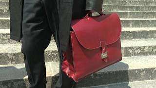 A lawyer for a former member of the Red Brigades leaves court in Paris on Thursday.
