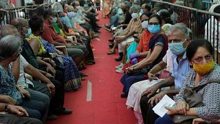 People wait to receive COVID-19 vaccine in Mumbai, India, Thursday, April 29, 2021.