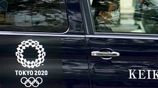 A taxi with the Tokyo 2020 Olympics logo on the door in Tokyo