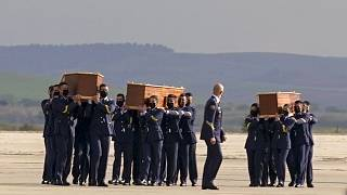 Coffins carrying the bodies of the victims arrived from Burkina Faso at Madrid's military airport on Friday.